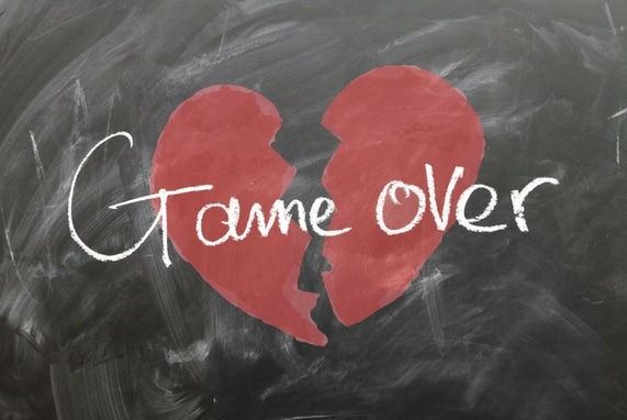 Lust Expires: Stop Playing, image of chalk board with a broken heart drawn with game over written over it.