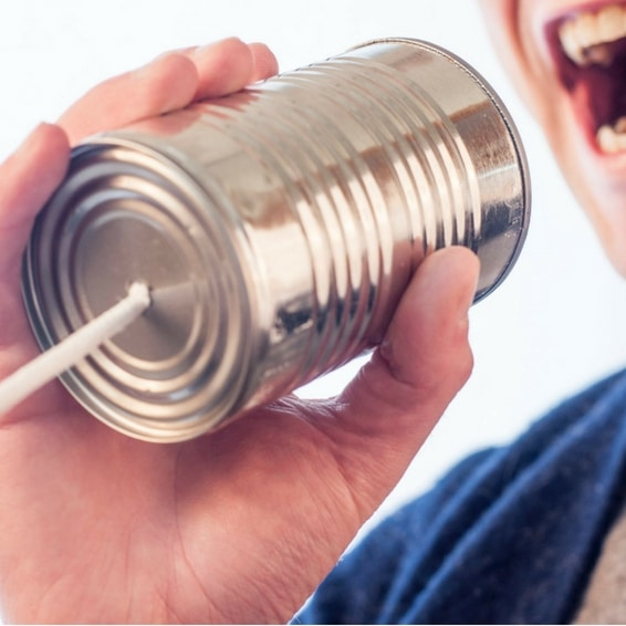 Public service announcement, image of a person holding a can to his mouth attached to a string to simulate a childhood way to communicate.
