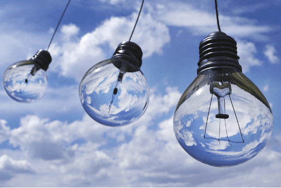 Contact Page, white clouds and blue sky, clear light bulbs are hanging from a string. You can see the clouds and sky through them.